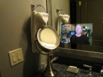 Bathroom at Iowa Hotel with TV in the Mirror