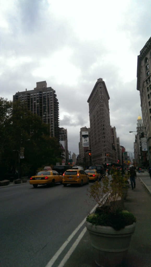 The Flat Iron Building As one crosses the street