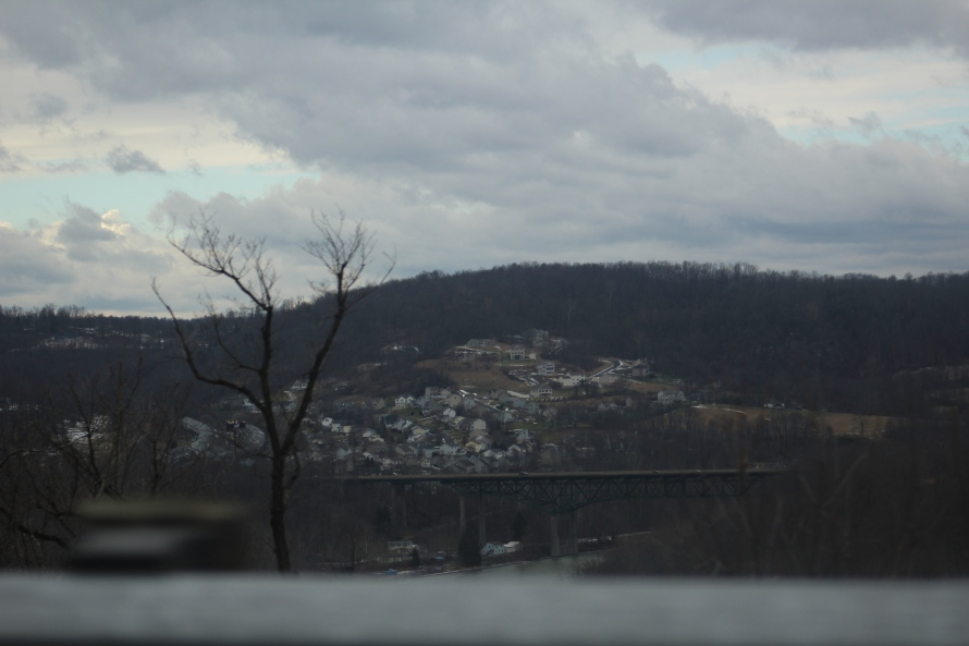 a sleepy town nestled in the hills under a lovely gray sky